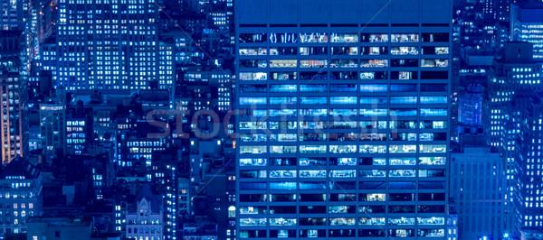 Iroda ablakok megvilágított éjszaka épület város Stock fotó © Elnur