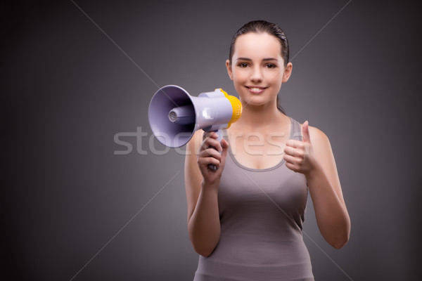Woman in sports concept with loudspeaker Stock photo © Elnur