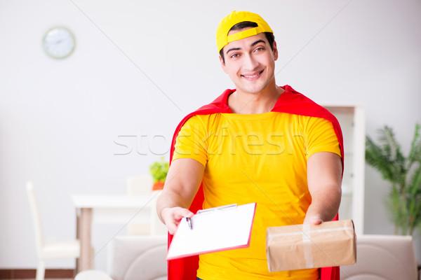 Superhero delivery guy with box Stock photo © Elnur