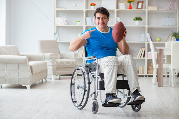 Young man american football player recovering on wheelchair Stock photo © Elnur