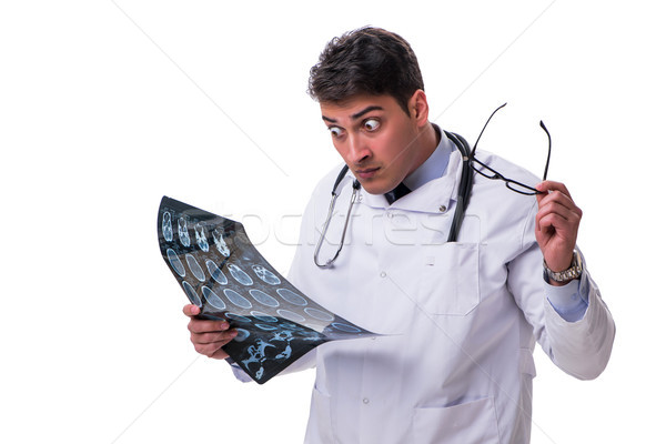 Young male doctor holding a radiograph isolated on white backgro Stock photo © Elnur