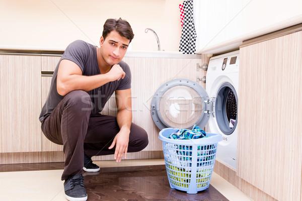 Młodych mąż człowiek pranie domu uśmiech Zdjęcia stock © Elnur
