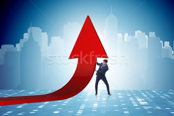 Stock photo: Businessman supporting growtn in economy on chart graph