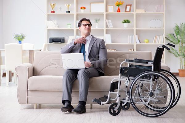 Işadamı tekerlekli sandalye çalışma ev özürlü iş Stok fotoğraf © Elnur