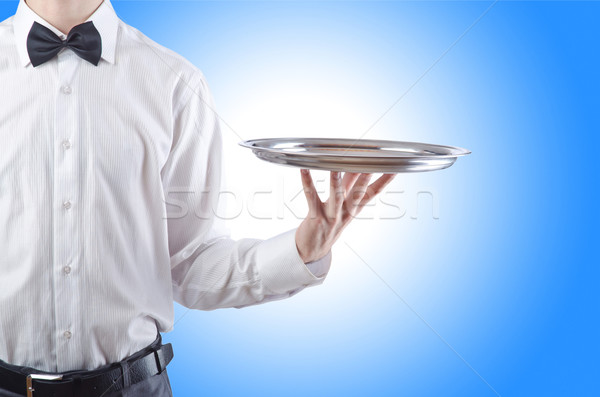 Young waiter with silver tray Stock photo © Elnur