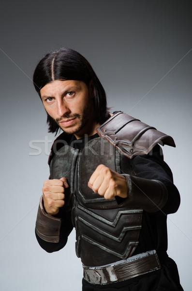 Angry warrior against dark background Stock photo © Elnur