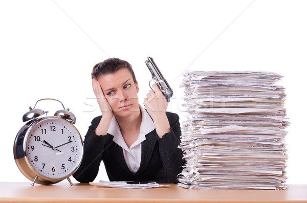 Woman with gun under stress from deadlines Stock photo © Elnur
