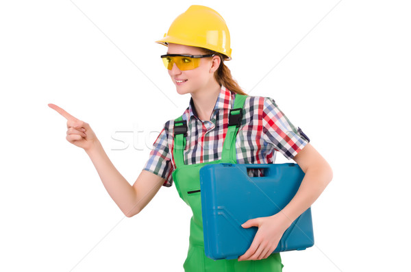 Builder female with toolbox pointing isolated on white Stock photo © Elnur