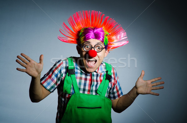 Funny clown against the grey background Stock photo © Elnur
