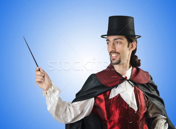 Magician doing tricks on white Stock photo © Elnur