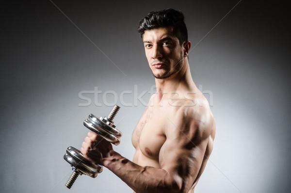 Kas vücut geliştirmeci dambıl spor uygunluk sağlık Stok fotoğraf © Elnur