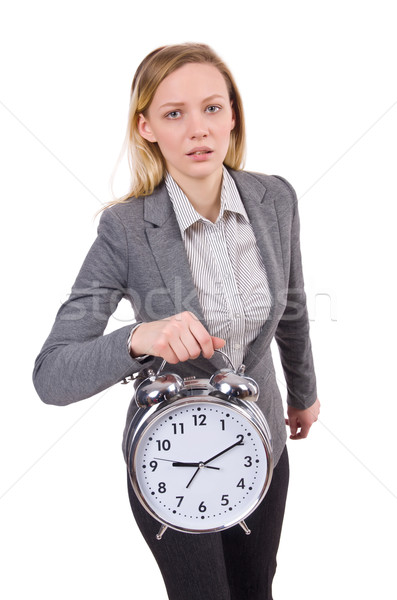 Businesswoman in gray suit holding alarm clock isolated on white Stock photo © Elnur