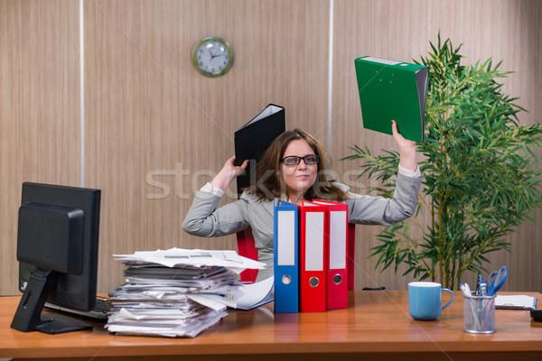 Businesswoman under stress working in the office Stock photo © Elnur