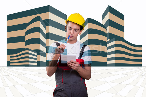 Young construction worker taking notes Stock photo © Elnur