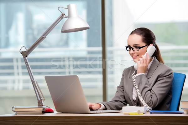 Call center operator working at her desk Stock photo © Elnur