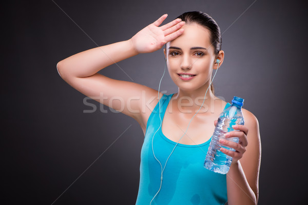 Woman doing sports with bottle of fresh water Stock photo © Elnur