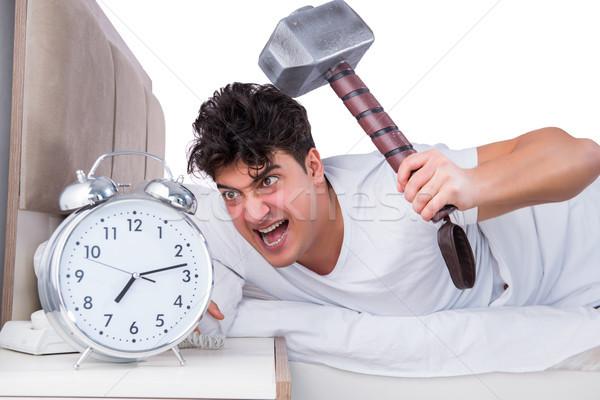 Homme lit souffrance insomnie horloge santé Photo stock © Elnur