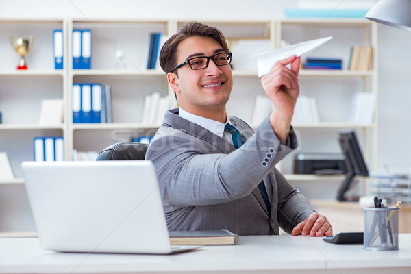 The businessman with paper airplane in office Stock photo © Elnur