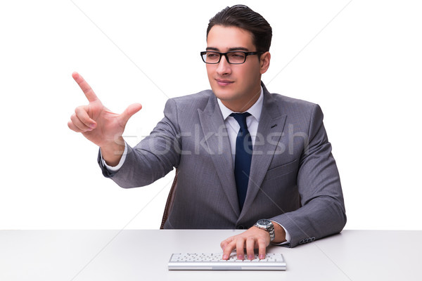 Young businessman typing on a keyboard pressing virtual buttons  Stock photo © Elnur