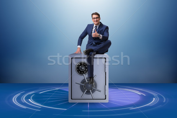 Excited businessman standing on top of safe Stock photo © Elnur