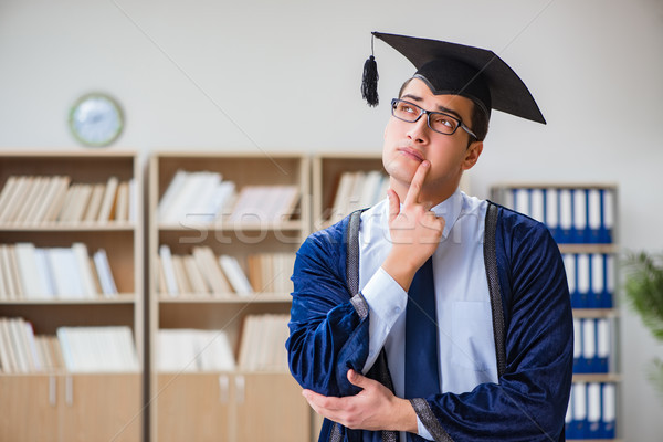 The young man graduating from university Stock photo © Elnur