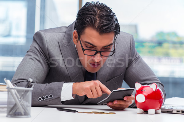 Bankrupt broke businessman with piggy bank Stock photo © Elnur