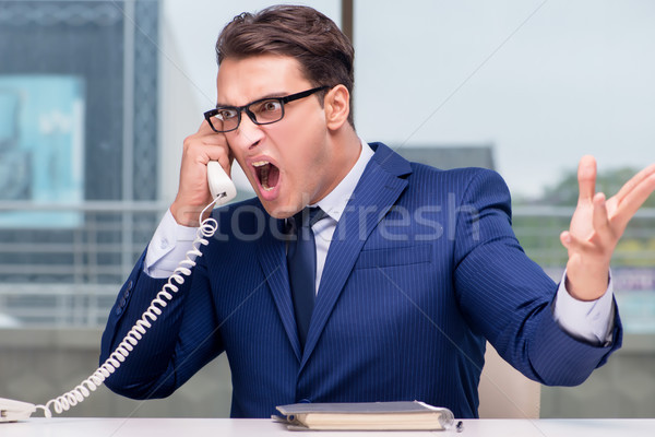 Angry call center employee yelling at customer Stock photo © Elnur