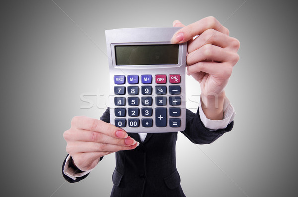 Funny accountant with calculator on white Stock photo © Elnur