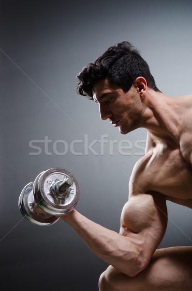 Muskuläre Bodybuilder Hanteln Sport Fitness Gesundheit Stock foto © Elnur