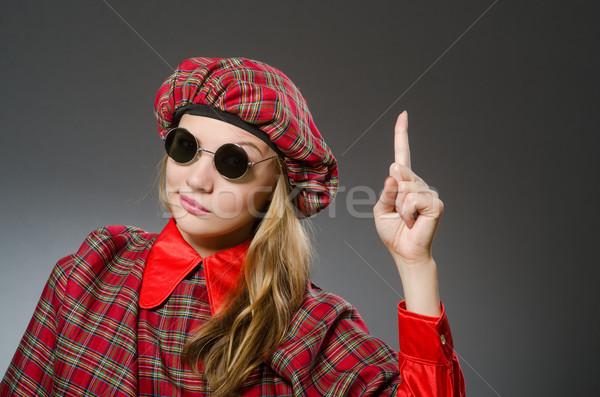 Woman wearing traditional scottish clothing Stock photo © Elnur