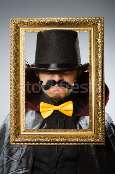 Funny man with picture frame Stock photo © Elnur