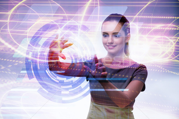 Businesswoman pressing virtual buttons in futuristic concept Stock photo © Elnur
