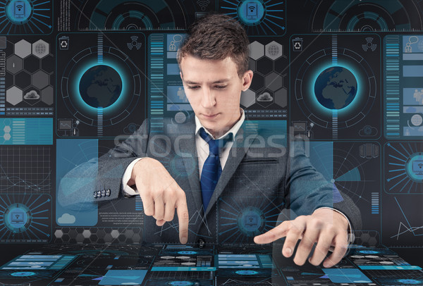 Young man in data management concept Stock photo © Elnur