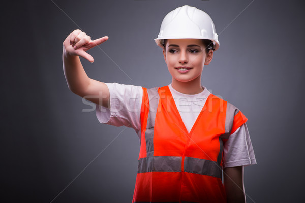 Cute travailleur de la construction boutons femme Photo stock © Elnur