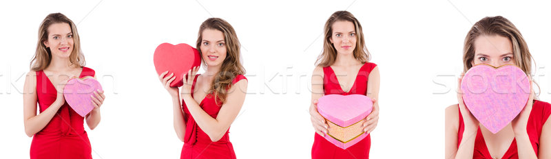 Pretty girl holding gift box isolated on white Stock photo © Elnur