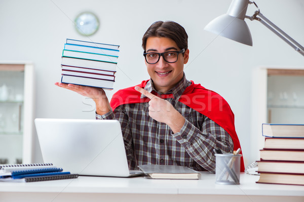 Super hero student with books studying for exams Stock photo © Elnur