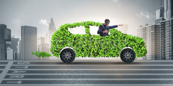 The businessman in green electric car concept Stock photo © Elnur