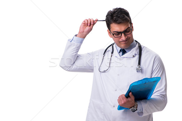Young male doctor with a writing board isolated on white backgro Stock photo © Elnur