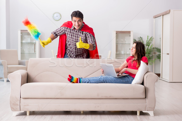 Superhero husband helping his wife at home Stock photo © Elnur