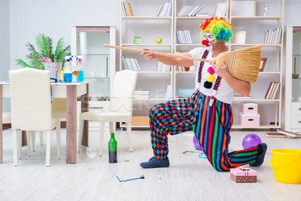 Funny clown czyszczenia domu uśmiech pistolet Zdjęcia stock © Elnur