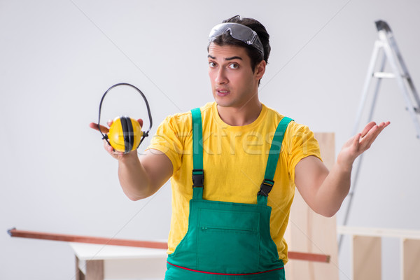 Worker showing the importnace of wearing noise cancelling headph Stock photo © Elnur