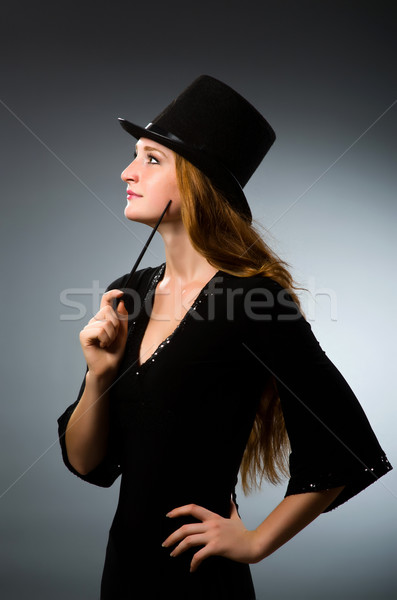 Woman magician doing her tricks with wand Stock photo © Elnur