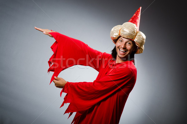 Funny wizard wearing red dress Stock photo © Elnur
