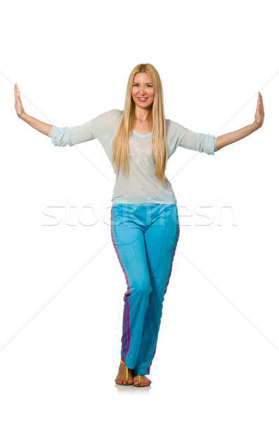 Young woman wearing blue training pants isolated on white Stock photo © Elnur