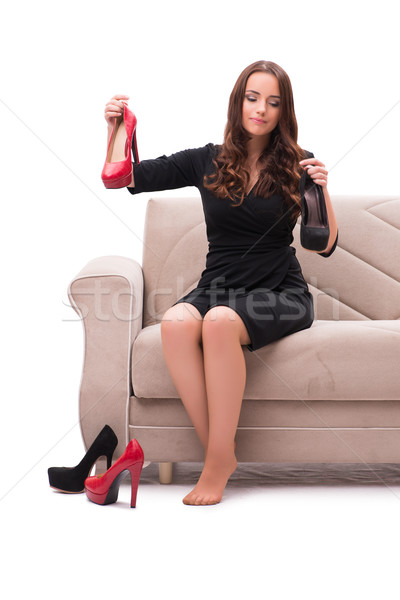 Woman having difficult choice between shoes Stock photo © Elnur