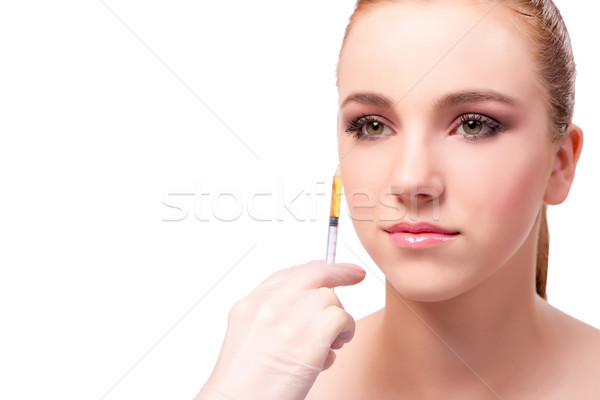 The young woman preparing for facial treatment isolated on white Stock photo © Elnur