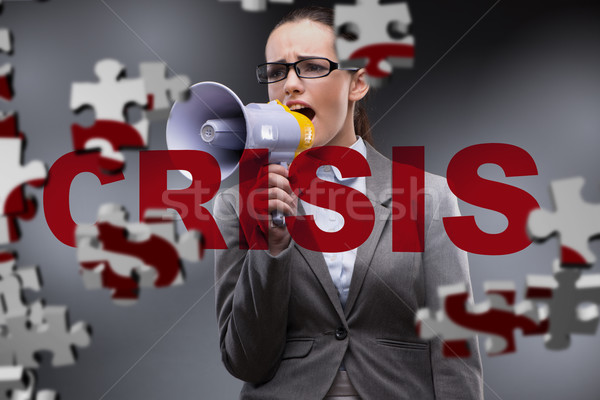 Woman with loudspeaker in crisis concept Stock photo © Elnur