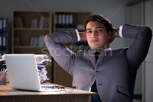 Man staying in the office for long hours Stock photo © Elnur