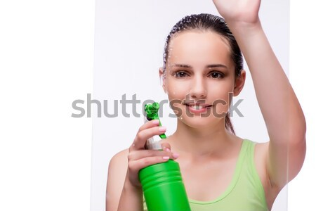 Young woman with bottle of perfume Stock photo © Elnur