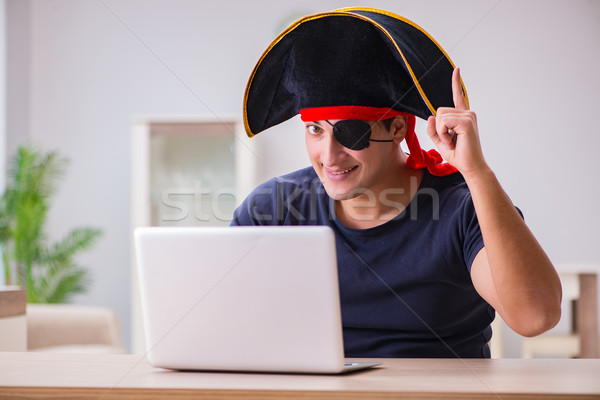 Digital security concept with pirate at computer Stock photo © Elnur